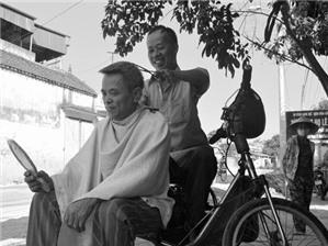 Mở quán cắt tóc vỉa hè, có phải đăng ký kinh doanh?
